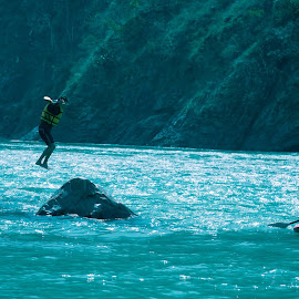 The dive into the Ganges by Kshitij Bhaswar - Sports & Fitness Watersports ( canon, cliff jumping, 5d mark3, cliff, sports, action, ganges, canon eos, diving, jump )