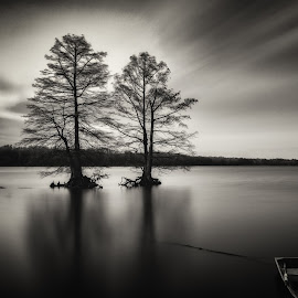 Busch Wildlife  by Kevin Zigrang - Black & White Landscapes ( no person, moody, dark, black and white, long exposure, clouds, lake, boat )