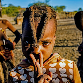 Tribal girl in Africa. by Doug Hilson - Babies & Children Children Candids ( africa, children, tribal, desert, village, eyes, child )