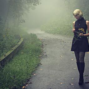 Long Walk Home by Freda Nichols - People Street & Candids ( walking, fog, woman, blond, road, flowers, , path, nature, landscape )
