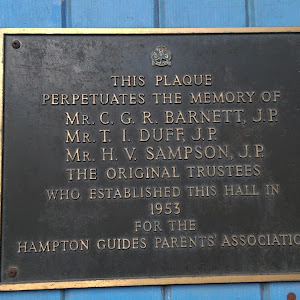 Plaque on entrance to the Guide Hall in Hampton Street, Hampton: Reads: THIS PLAQUE PERPETUATES THE MEMORY OF MR. C. G. R. BARNETT, J.P. MR T. I. DUFF, J.P. MR H. V. SAMPSON, J.P. THE ORIGINAL ...