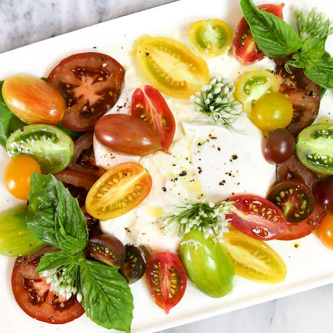 Heirloom Tomato and Burrata Salad with Garlic Blossoms and Basil