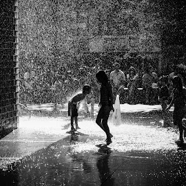 Summer in the City by Todd Dubé - Black & White Portraits & People ( water, fountain, children, silhouettes, silhoutte, chicago, kids, light, city, street photography )
