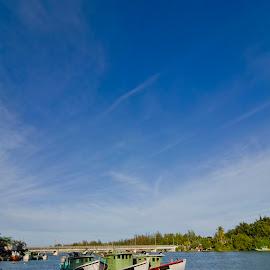 three fisherman boat side by side by Xicro Kuyon - Transportation Boats ( water, sky, pier, travel, jetty, bridge, boat, landscape, river )