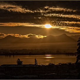 Sunset among clouds by Vibeke Friis - Landscapes Sunsets & Sunrises ( water, clouds, sky, sun,  )