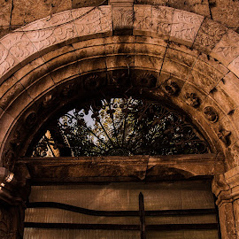 The Arch by Rose Lindquist - Buildings & Architecture Architectural Detail ( building, old, detail, lighting, arch, rock, architecture, hues, arch ways )