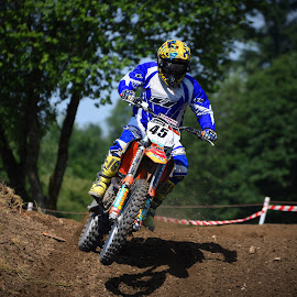 Re-Accelerating by Marco Bertamé - Sports & Fitness Motorsports ( motocross, blue, dust, clumps, race, alone, accelerating, competition )