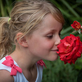 Love this photo of Dakoda. A little rose smelling a rose. by Cora Lea - Babies & Children Children Candids