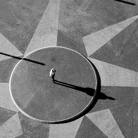 Sun Dial by VAM Photography - Black & White Street & Candid ( b&w, sun dial, shadow, sun, man )