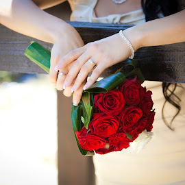 Bride holding a wedding bouquet by Cornel Achirei - Wedding Details ( bouquet, detail, fashion, colorful, holding, occasion, vibrant, leaf, valentine, party, romance, blossom, caucasian, hand, love, married, accessory, hands, fresh, woman, happy, event, bunch, bride, flowers, passion, marry, flower, closeup, ring, elegance, green, beautiful, romantic, happiness, ceremony, young, holiday, arrangement, bridal, female, dress, wedding, wife, outdoors, roses, matrimony, celebration, engagement )