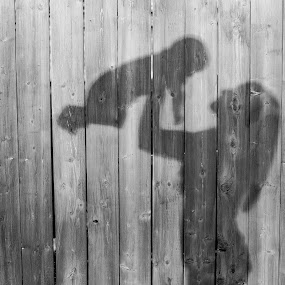 Playful shadow by Frederic Rivollier - People Family ( fence, wood, shadow, outdoor, play, dark, fun, mom, kid )