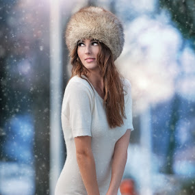Attractive young woman in a winter fashion shot.Winter wild girl on snow by Iancu Cristi - People Fashion ( seasonal, makeup, fairy, snowflake, feather, caucasian, sexy, cold, flake, woman, lifestyle, snow, glamorous, eye, cool, wild, xmas, happiness, forest, portrait, holiday, december, winter, eyelash, one woman only, face, fashion, model, clothing, joy, beauty, cute, pretty, glamor, fantasy, girl, happy, attractive, grey, beautiful, christmas, expressing positivity, gloves, adult, young, princess, female, blue, elegant )