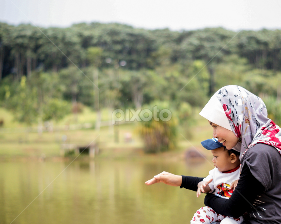 a mother's love by Rafie Rosli Putra - People Family ( leaning, beutiful, beautiful, unconditional, son, lake, mom, ibu, love, anak, pwcmothers-dq, life, mother, awesome, life long, happy, woman, mother's day, instinctual )