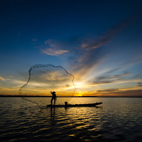 fisherman by Chanwit Whanset - Landscapes Sunsets & Sunrises ( fishing net, sillouette people, fishing, fisherman, net, fishing boat )