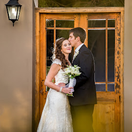 Kiss me in the doorway by Lodewyk W Goosen (LWG Photo) - Wedding Bride & Groom ( wedding photography, wedding photographers, weddings, wedding day, wedding, brides, bride and groom, wedding photographer, bride, wedding destination, groom )
