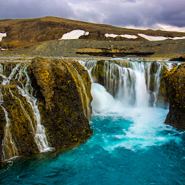 The Waterfall of Landmannalaugar! by Avishek Patra - Landscapes Waterscapes ( canon, stream, europe, mountain, flowing, colorful, waterfall, cliff, scenic, travel, landscape, island, contrast, landmannalaugar, iceland, nature, cascade, akpphotography, photographer, blueandwhite )