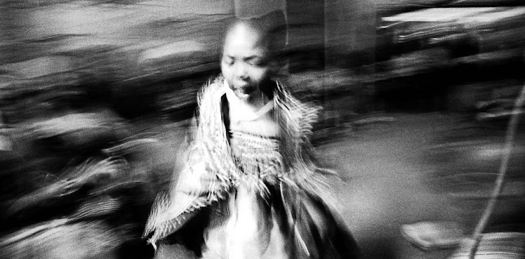 'Portrait of a Young Thwasa' (2008) is one of the photographs in 'Footprints' that emphasise everyday black life in South Africa