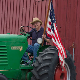 4th of July tractor ride by Gale Perry - People Portraits of Men ( red, green, american flag, tractor, man,  )