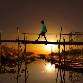 Boy Crossing Bamboo Bridge by Jun Santos - Landscapes Sunsets & Sunrises ( waterscape, sunset, bridge, landscape, boy )