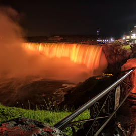 Summer Night In Niagara Falls by Ken Chambers - City,  Street & Park  Night ( park, canada, night scene, colorful, waterscape, illumination of the niagara falls, colors, beautiful, waterfall, street, ontario, niagara parks, landscape, illumination of the falls, colour, nature, color, niagara falls, parks, parks canada, long exposure, night, niagara, illumination )