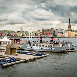 Stockholm view from the City Hall by RicardMN Photography - City,  Street & Park  Vistas ( skyline, harbor, europe, stockholm, shipping pier, metropolitan, street, architecture, dockside, summerly, dock, photography, baltic, stadshusbron, buildings, cloudy, ships, djurgarden, built, downtown, scandinavian, skyscape, water, ricardmn photography, clouds, city hall, nordic, sweden, church, cruise ship, boats, capital city, kungsholmen, urban landscape, panoramic view, bird, baltic sea, lake klara, city hall bridge, norrmalm, klara sjo, town, nordic region, ricardmn )