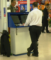 Example of non-compliant situation where members of the public are able to view CCTV screens when stood behind CCTV operator