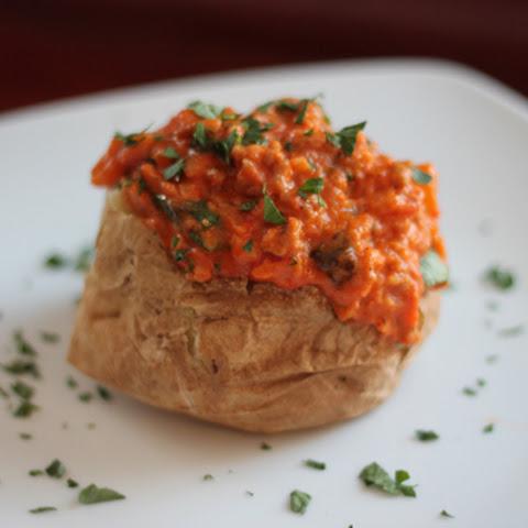 Baked Potato with Sausage and Arugula Sauce