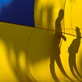 People silhouette outside hot air balloon. by Gale Perry - Artistic Objects Other Objects ( hot air balloon, yellow., blue, silhouette, people,  )