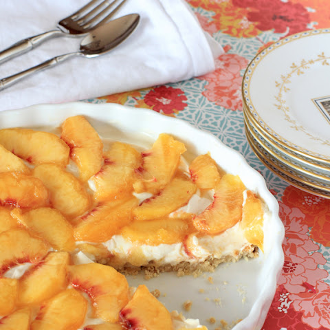 Peach and Berry Cheesecake Tart with a Cinnamon Almond Crust