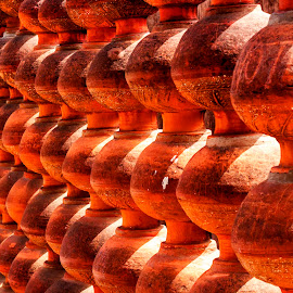Pots by Nalin Sharma - City,  Street & Park  Amusement Parks ( rock garden, pattern, chandigarh, shadows and light, orange light, mud pots, , mood factory, color, lighting, moods, colorful, light, bulbs, mood-lites )