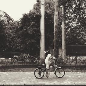 keep on riding  by Yosh Ginsu - People Street & Candids ( girl, street, candid, kids, bicycle )