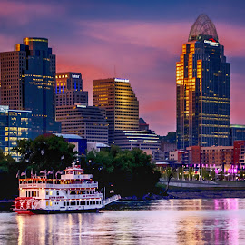 Sunset on the River by Richard Michael Lingo - Transportation Boats ( skyline, ohio, waterscape, boats, cincinnati, cityscape, transportation )