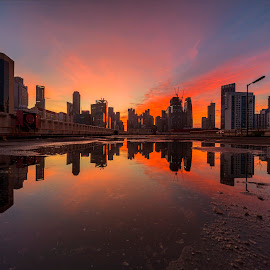 by Gordon Koh - City,  Street & Park  Skylines ( puddle, sunrise, reflection, city, asia, city park, clouds, skyline, epic sunrise, building, rain puddle, singapore, modern, urban, symmetry, cityscape, hotel, modern city, movement, park, architecture )