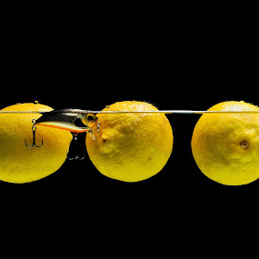 Lure with lemons in water by Nikola  Pejcic - Food & Drink Fruits & Vegetables ( water, lemons, food, fishing, yellow, lure )