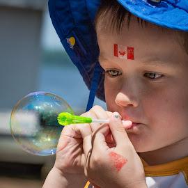 Concentration by Dave Lipchen - Babies & Children Children Candids ( child, canada day, bubbles, blowing bubbles )