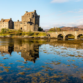 Eilean Donan Castle by Kevin Warrilow - Buildings & Architecture Public & Historical ( water, scotland, scottish highlands, eilean donan, castles, reflections, bridges )
