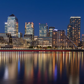 Canary Wharf against the blue sky by Augustin Galatanu - City,  Street & Park  Skylines ( uk, london, offices, blue hour, canary wharf, reflexions, city at night, street at night, park at night, nightlife, night life, nighttime in the city )