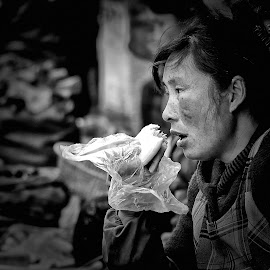 Very Difficult Meal by Freddy Ng - People Street & Candids ( market, portraits of women, black and white, poverty, woman, wet market, shanghai, street photography, china )