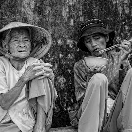 by Kathryn Potempski - People Street & Candids ( hunger, black and white, sad, homeless, candid, vietnam, women, photography )