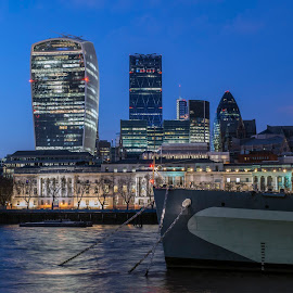 Looking across to the City of London with the bow of HMS Belfast in the foreground by Chris Cooper-Mitchell - City,  Street & Park  Skylines ( city of london, gherkin, thames, london, hms belfast, cityscape, nikon, nightscape, city, city at night, street at night, park at night, nightlife, night life, nighttime in the city )