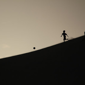 Take Chase by Anthony Schwab - Babies & Children Children Candids ( ball, foot ball, sand dune, play, qatar, travel, at dusk, take chase after a soccer ball )