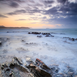 Five Finger Strand Sunset 3 by Graham Daly - Landscapes Waterscapes ( water, sand, ireland, seascapes, county donegal, inis eoghain, twilight, sea, five fingers strand, ocean, beach, coastal, graham daly photography, coast, lee filters, sunset, inishowen peninsula, long exposure, landscapes, rocks )