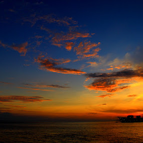 A Ship and Sunset by Endy Wiratama - Landscapes Weather