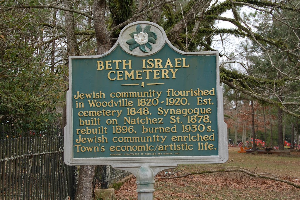 Jewish community flourished in Woodville 1820-1920. Est. cemetery 1848. Synagouge built on Natchez St. 1878, rebuilt 1896, burned 1930's. Jewish community enriched Town's economic/artistic life.