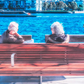 Old couples by Jijo George - People Couples ( person, old, single, blond, beach, leaves, people, together, hat, aged, caucasian, love, retirement, married, nature, autumn, woman, family, lifestyle, age, care, something, smile, cheerful, smiling, lover, affection, laugh, dream, white, pleasure, happiness, forest, fun, youth, health, portrait, grey hair, sign, outdoor activities, european, vacation, dentistry, season, 60 years old, tenderness, tooth, outdoors, adults, active, natural, walk, senior, face, whitening, lovers, maturity, one, retired, holidays, retire, ocean, husband, dental, sixties, elder, hand, hands, happy, older, showing, 60s, couple, man, closeup, aging, seashore, park, enjoying, hugging, male, beautiful, wearing, adult, human, pensioner, female, mature, wife, background, fall, embracing, summer, lady, healthy, elderly, old people )