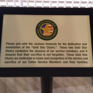 This plaque is located right beyond the guest services booth inside The Ballpark at Jackson. There is a chain surrounding the two chairs, and the plaque reads: