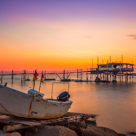 Trabocco Cungarelle by Luca Nicoletti - Landscapes Waterscapes ( waterscape, abruzzo, sea, long exposure, stilt house, beach, sunrise, waterscapes, boat, adriatic sea, italy, sun )