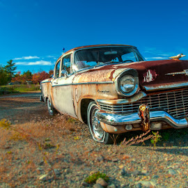 A Little Retro by Chris Cavallo - Transportation Automobiles ( clouds, studebaker, old car, maine, retro, rusty, rust, decay, abandoned )