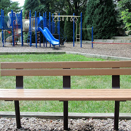 Bench in the children's playground by Maricor Bayotas-Brizzi - City,  Street & Park  Neighborhoods