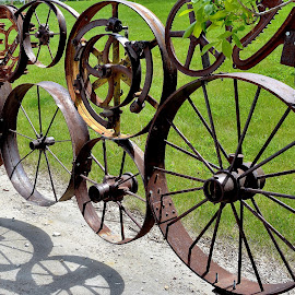 Fence of Wheels by Erin Czech - Artistic Objects Antiques ( fence, montana, shadow, wheels, iron )
